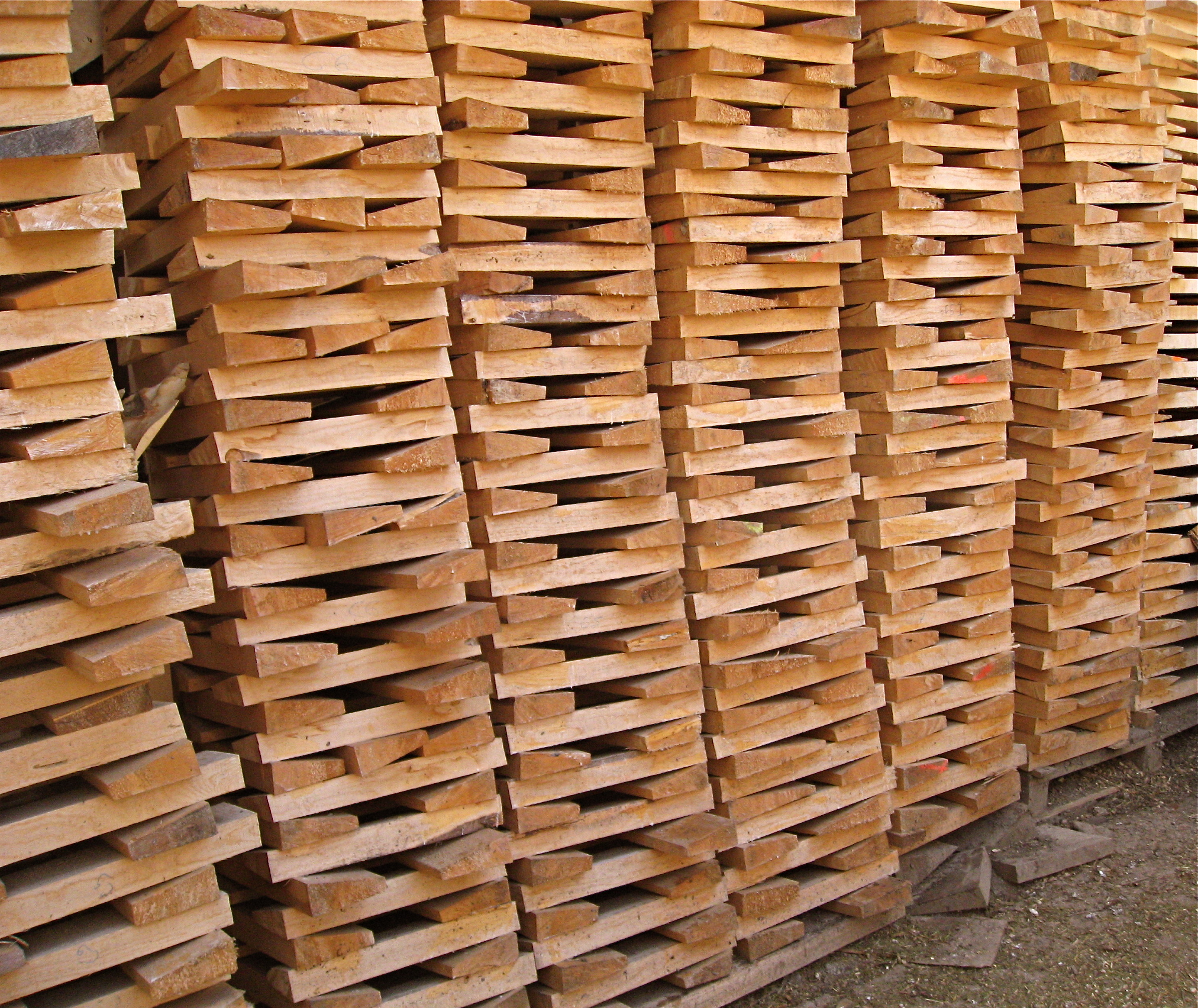 Wedges of violin wood stacked to season in Germany