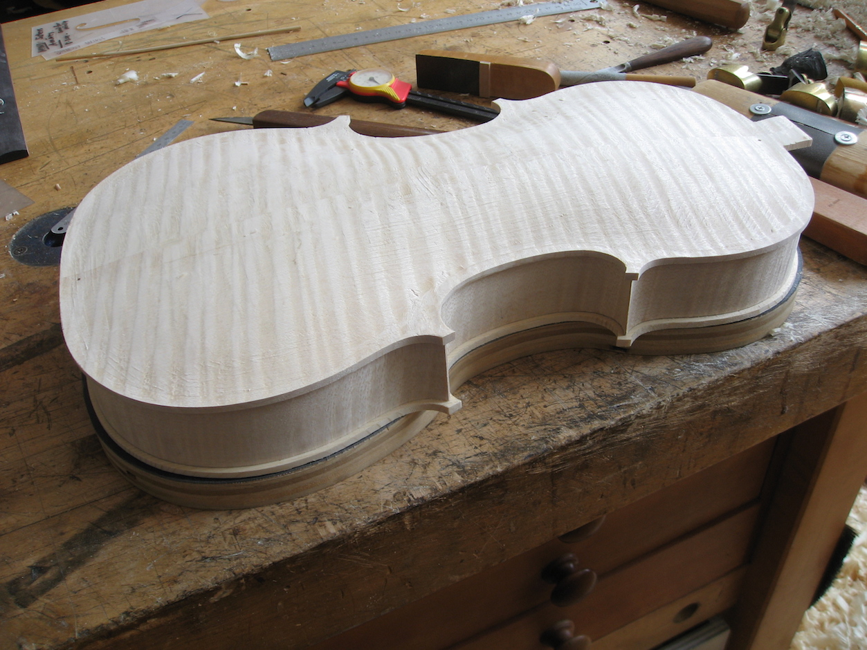 The edge profile is refined in preparation to inlay the purfling